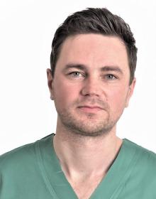 Dr. Marius Kurminas